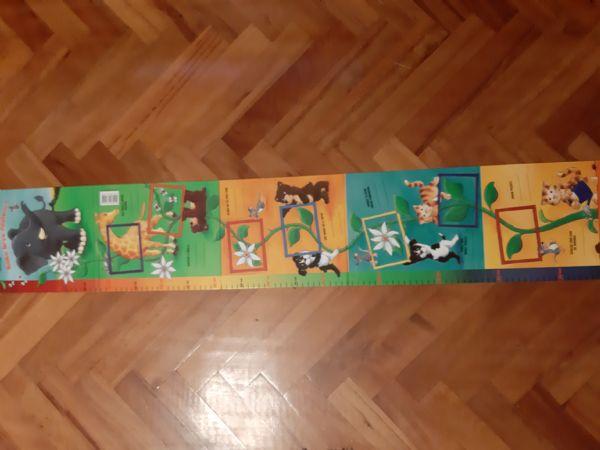 Kako brzo rastem! : knjiga-mjerilica / Claudia Fries